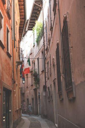 Picturesque Italian narrow street in Orta San Giulio town. Tourist destination.
