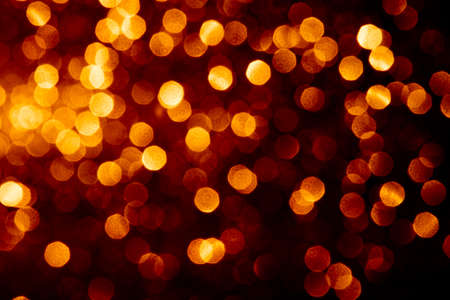 Abstract gold color defocused bokeh background. Holiday festive concept. Christmas lights.