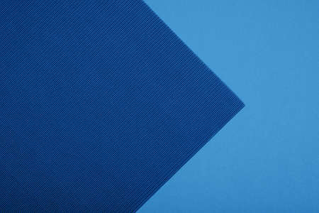 Abstract geometric paper background. Blue trendy colors. Geometric vibrant colors textured flat lay. Stock Photo