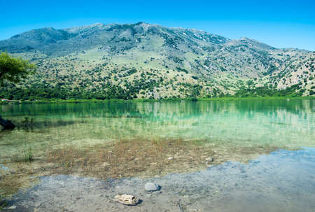 Exciting view to crystal turquoise green lake near mountain. Greece, Island Crete. Stock fotó