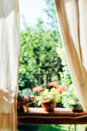 Blurred background of beautiful view from the balcony on a garden. Romantic morning abstract background. Stock fotó