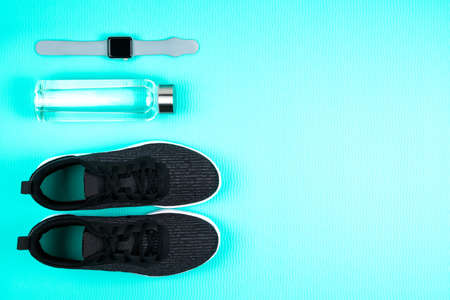 Top view of wavy blue cyan background made from mat for yoga or sports. Yoga pilates sport concept. Flat Lay. Copy space.