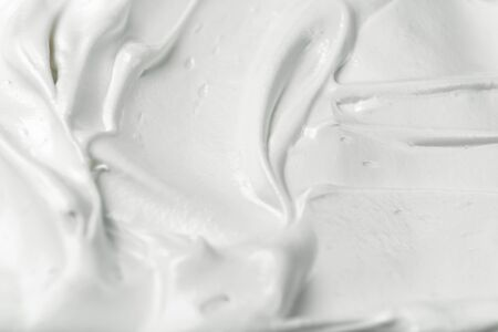 White meringue cream texture. Whipped white egg texture. Latte foam. Whipping cream.
