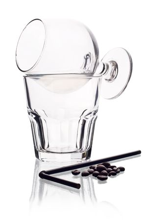 saki: Two glasses with sambuca on white background.