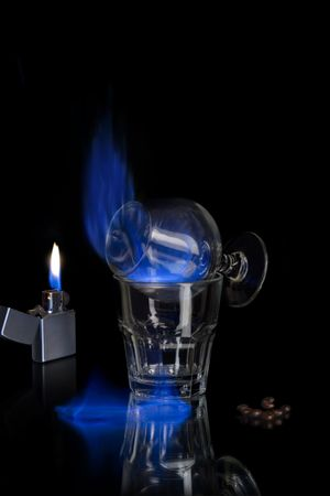 Flaming sambuca over black Stock Photo - 4814608