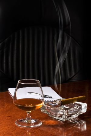 snifter: Snifter glass of cognac and cigar  Stock Photo