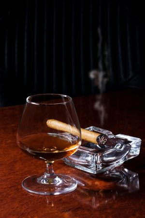 Snifter glass of cognac and cigar Stock Photo - 6450313
