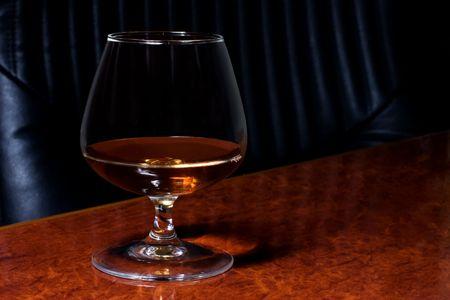 snifter: Snifter glass of cognac Stock Photo