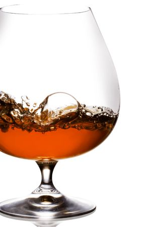 brandy: Snifter glass of cognac on white background.