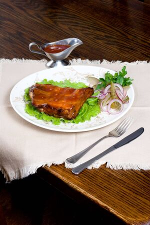 garnishments: Meal of meat with vegetables and garnishments on a white plate. Stock Photo