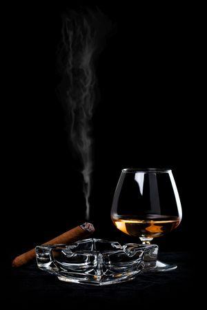 smoking a cigar: Snifter glass of cognac and cigar
