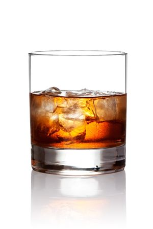 Glass of scotch whiskey and ice photo