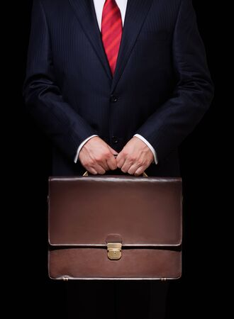 portfolio: business person holding a briefcase