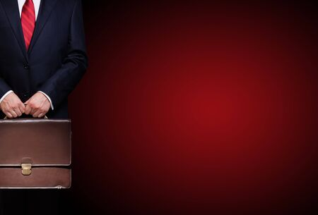 business person holding a briefcase Stock Photo - 7603970