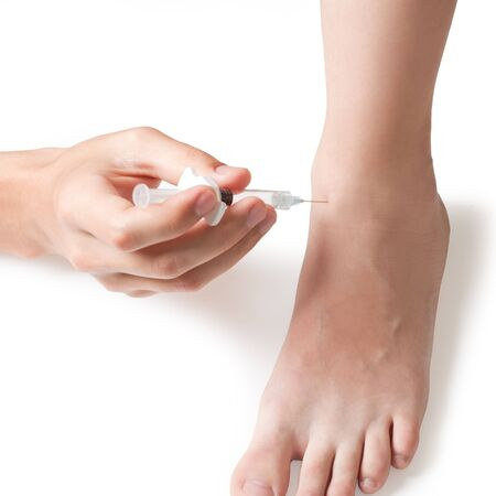 foot pain: intra-articular injection Stock Photo