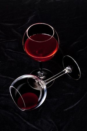 Glass of red wine on a Black background Stock Photo - 7604409