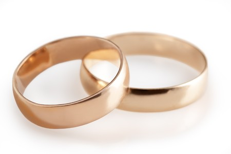 pink wedding: wedding rings and roses  Stock Photo