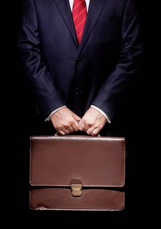 briefcase: business person holding a briefcase