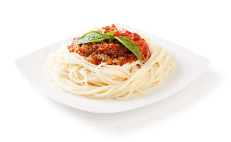 bolognese sauce: Spaghetti bolognese with cheese and basil on a white backgroundand with soft shadow Stock Photo