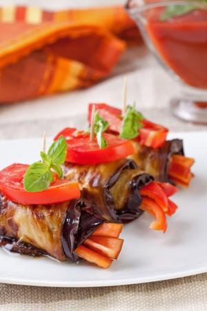 Eggplant rolls stuffed with pepper photo