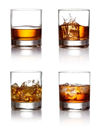 whiskey glass: Glass of scotch whiskey and ice  on a white background