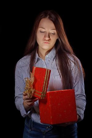beautifull girl opening gift box. Black background Stock Photo - 8283081