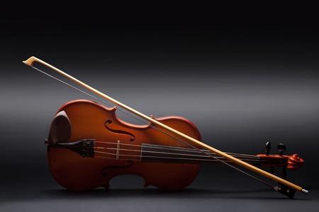 fiddlestick: Violin on black background
