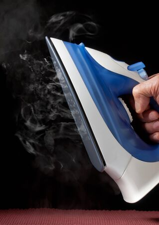 electric iron emitting steam Stock Photo - 10283083