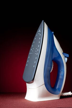 electric iron on a black background Stock Photo - 10335538