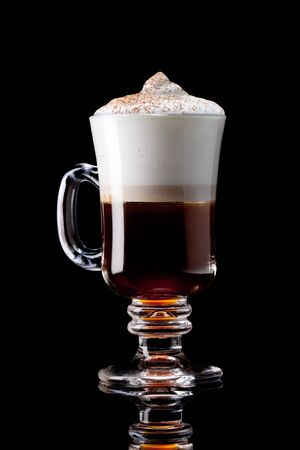 hot coffees: cup of coffee on a black background