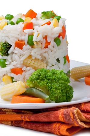 Rice and vegetables on a white background photo