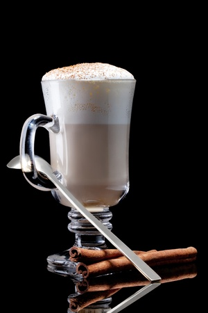 cup of coffee latte macchiato on a black background photo