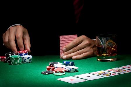 poker table: Man playing poker