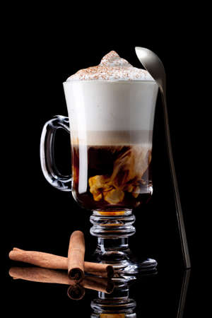 hot coffees: cup of coffee latte macchiato on a black background Stock Photo