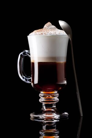 latte macchiato: cup of coffee on a black background