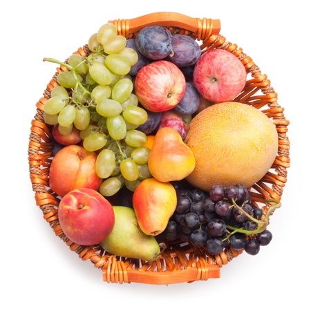 Assortment of fruits (melon, plum, pear, grapes, peach, apple ) photo