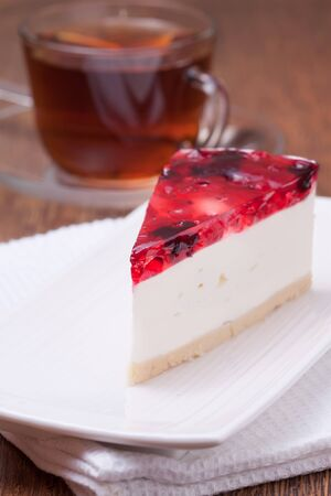red currant: cheesecake Dessert served on a plate