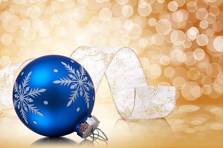 blue ball: christmas balls and ribbon serpentine on a holiday lights background