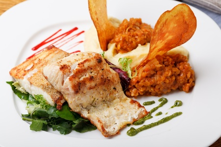 roasted pikeperch fillet with mashed potatoes photo