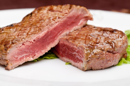 Grilled steak chargrilled to medium rare Stock Photo