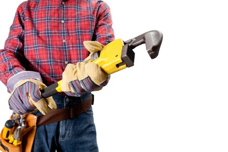 Plumber holding pipe wrench over white background photo