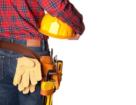 cinturon seguridad: Trabajador de la construcci�n con el cintur�n de herramientas en blanco Foto de archivo
