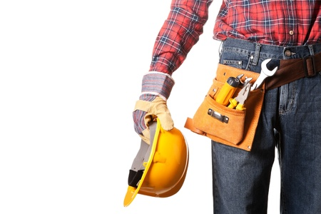 Construction worker with toolbelt on white photo
