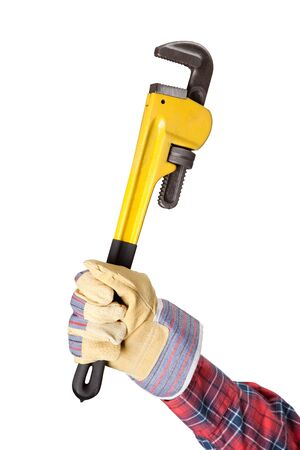 Pipe Wrench in hand over white background photo