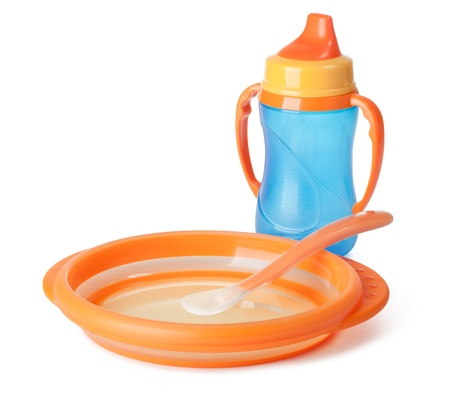baby goods: baby tableware on a white background Stock Photo