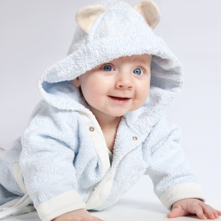 portrait of a cheerful child in blue bathrobe photo