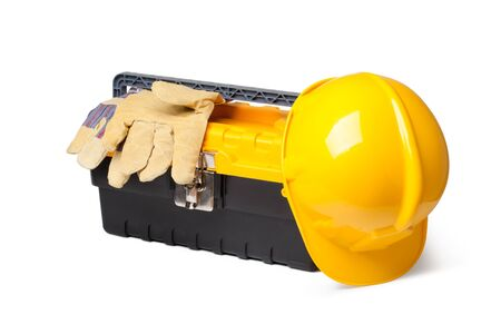Hard Hat, Leather Gloves and toolbox isolated on white photo
