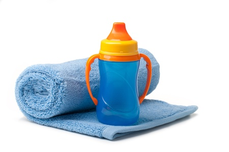 Baby blue bottle on a white background photo