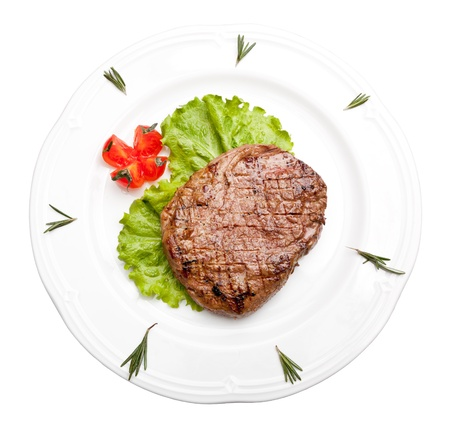 beef meat: Grilled steak on a white plate Stock Photo