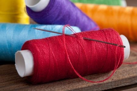 Pile of coloured bobbins of thread Stock Photo - 12766143